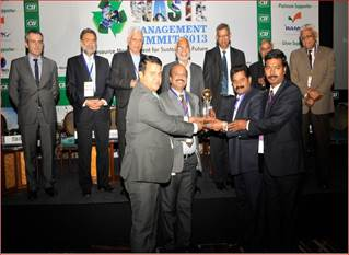 S V Arunachalam and Sandeep Chaudhari receiving the awards for GVK BIA